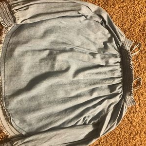 An off the shoulder dusty blue top